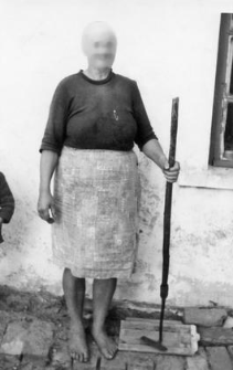 Female clothing and a tool for cleaning cinder from bakery oven