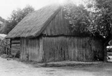 A half-log, half-timbered barn