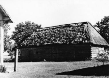A barn - half-timbered, a hipped roof, covered with straw