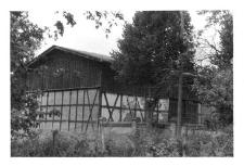 A frame-brick barn