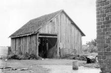 A barn with a narrow facade