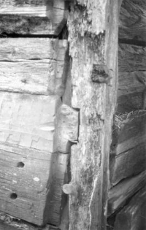 A fragment of a post-and-plank barns wall
