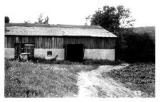 A brick barn with a pigsty