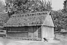 A post-and-plank barn