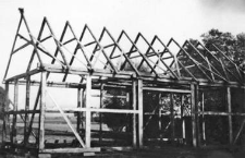 A half-timbered barn under structure
