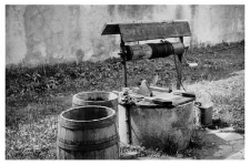 A well with a winch, barrels
