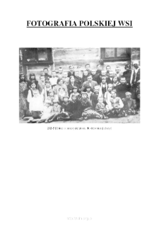 [Children with a teacher in front of the wooden hut] [An iconographic document]