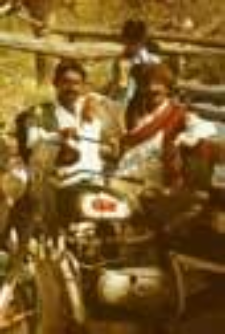 Portrait of two men with motorcycle (Iconographic document)